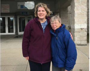 Trish and Edna standing in front of the prison